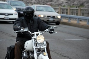 motorcycle rider in traffic